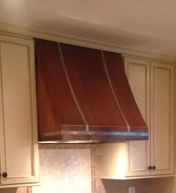 Copper range hood with stainless straps
